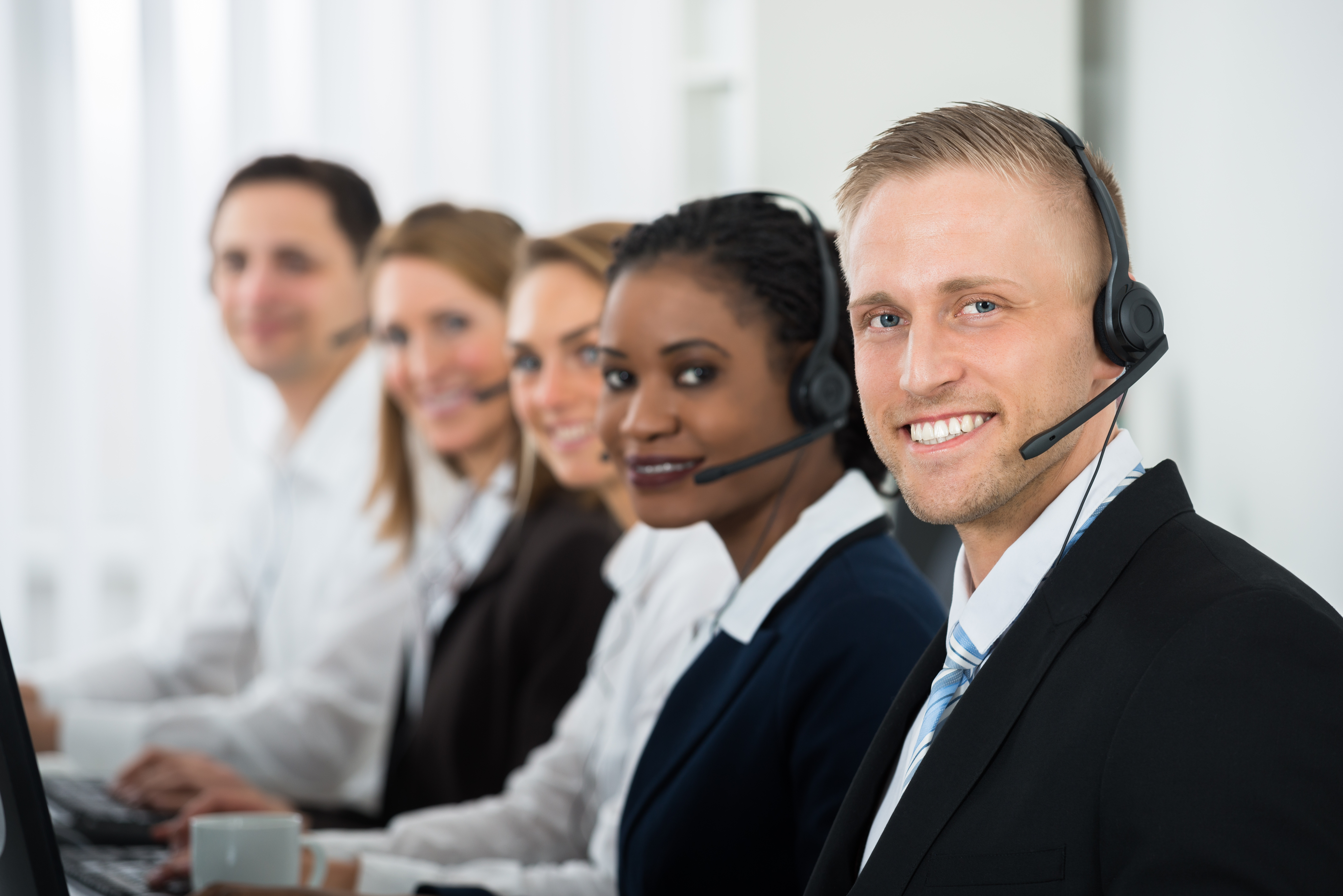 Image of call center agents in formal attire.