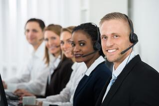 Call center agents in formal attire.