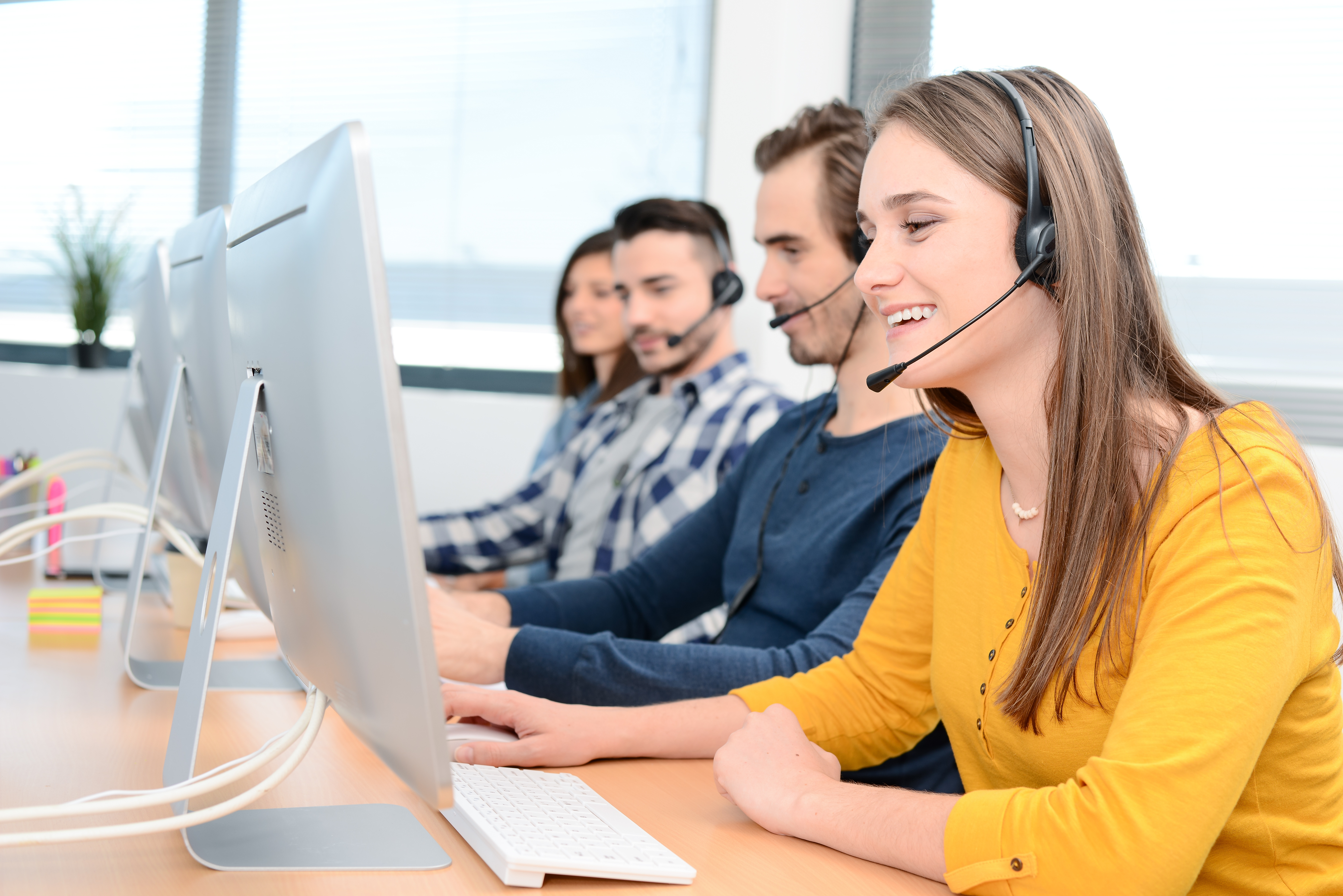 Outbound call center agents smiling