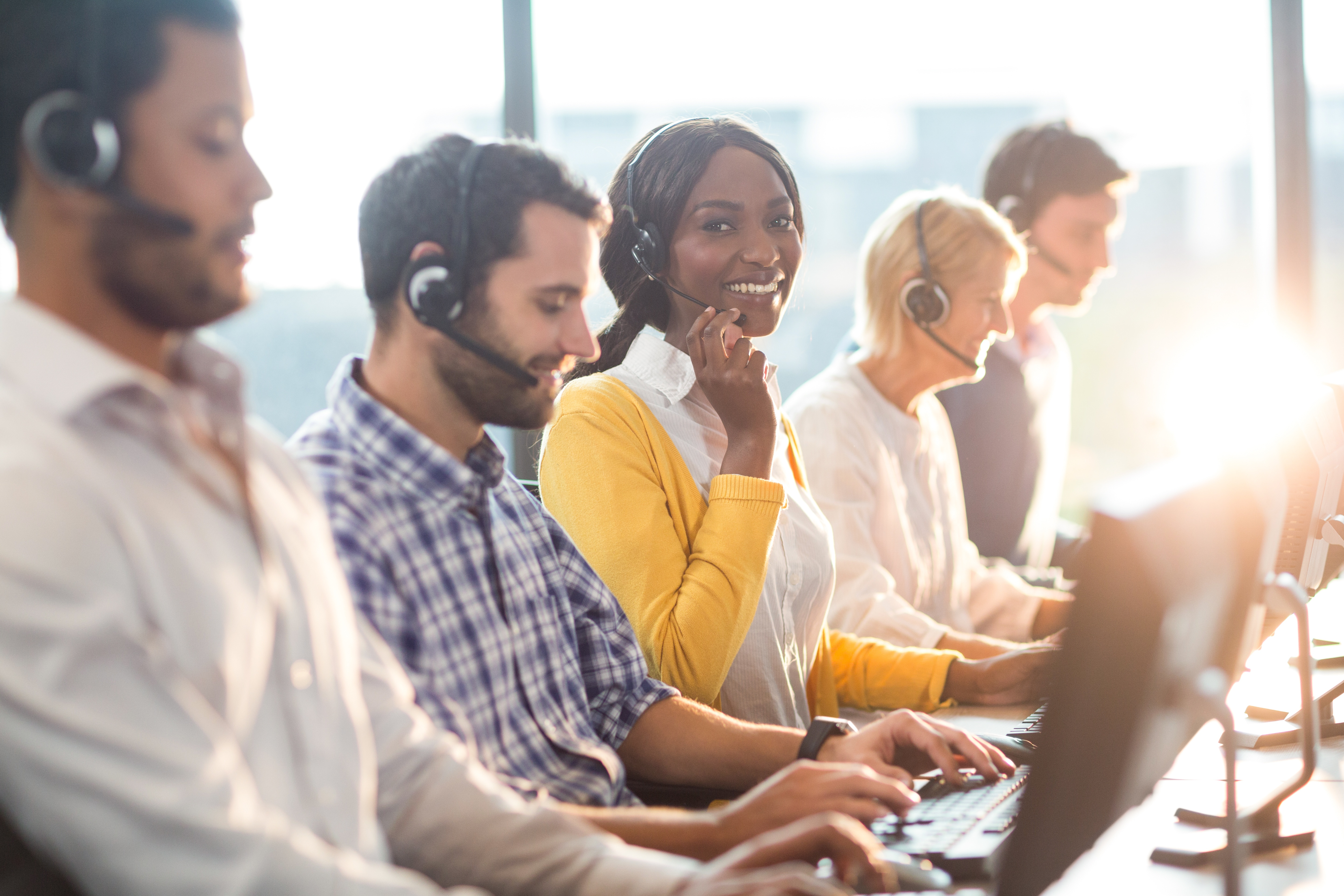 These smiling call center agents can help improve customer loyalty.
