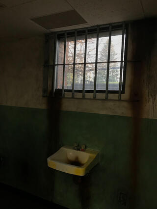 """Prison"" window and sink."