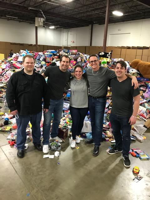 Outsource Consultants at the Toys For Tots warehouse.jpg